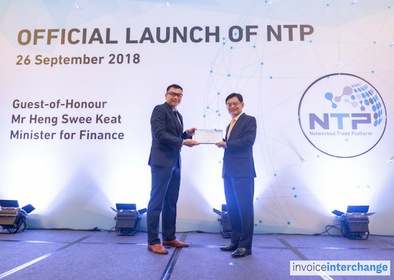Mr Heng presenting NTP Certificate of Appreciation to Kirk Chang, our head of risk